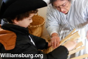A young boy learns how to weave a basket